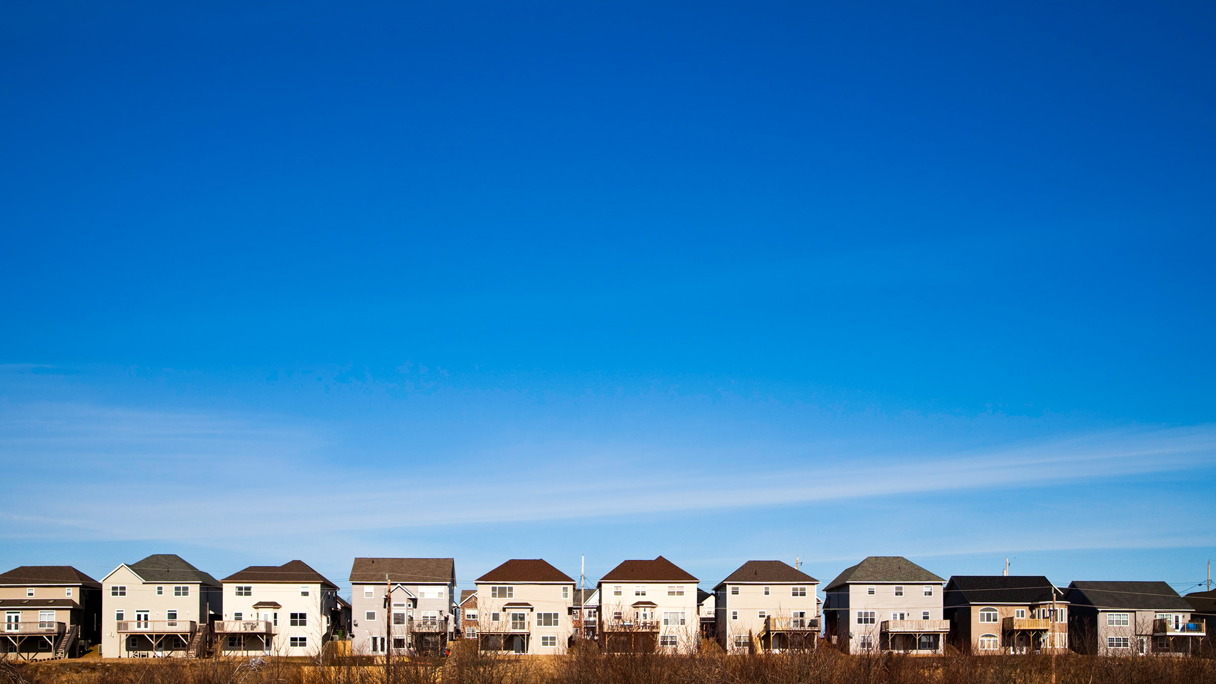 A row of houses beneath the blue sky
